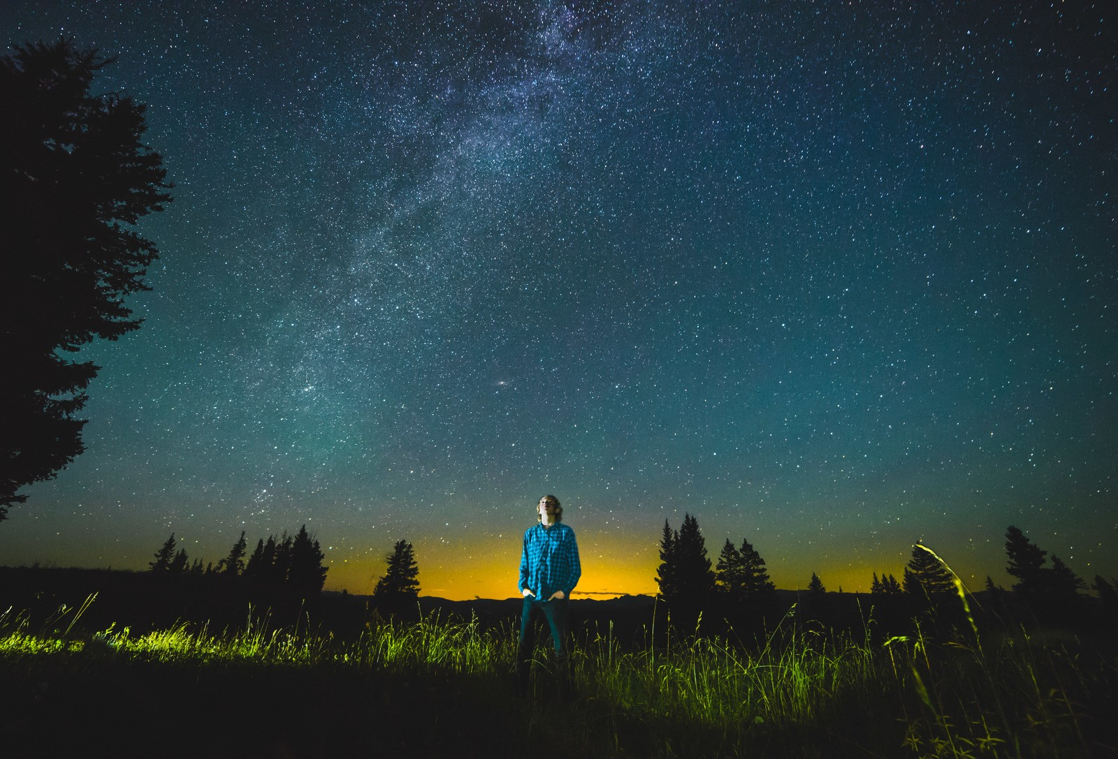 Man Standing on Lawn at Nighttime by Hunter-Bryant
